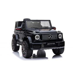 Mercedes G New, color negro, con licencia original, batería, puertas que se abren, asiento individual, 2 x motor, batería de 12 V, control remoto de 2.4 Ghz, suspensión trasera, arranque suave